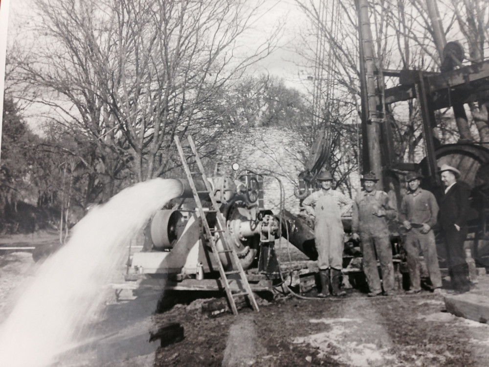 Crews pose with a newly-completed water well at the site in December of 1944 (from Sophienberg Museum)