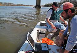 Surveyors Inspect Equipment Readings