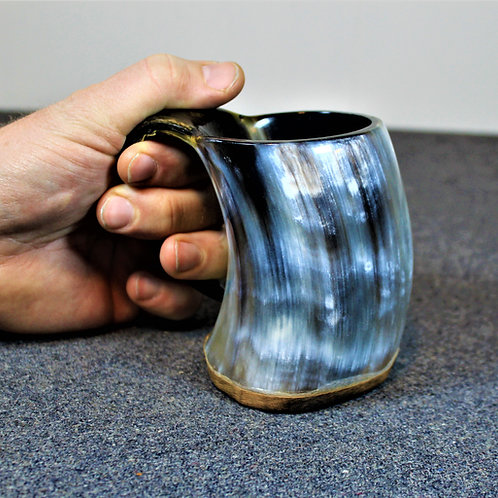 Drinking horn mug, black and white, holds a beer