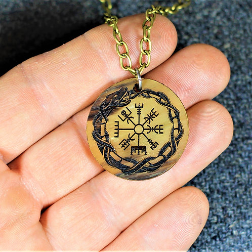 Ourobos encircling a runic compass, carved horn necklace