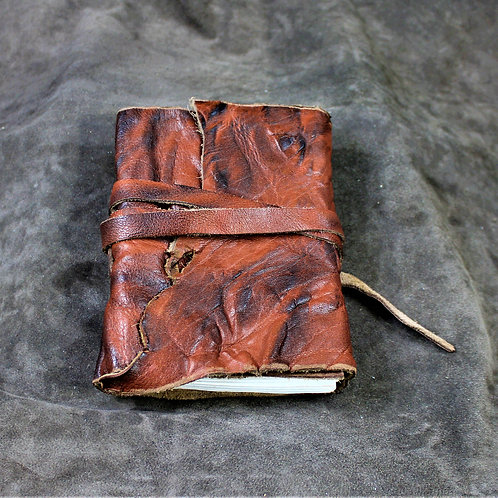 Red leather grimoire, spellbook, artbook or journal