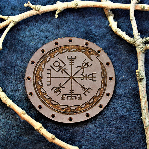 Ourobos encircling a runic compass, carved brown leather patch