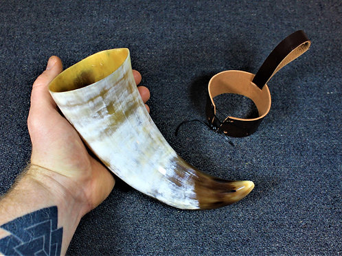 Drinking horn, stout, brown and white, with belt holster