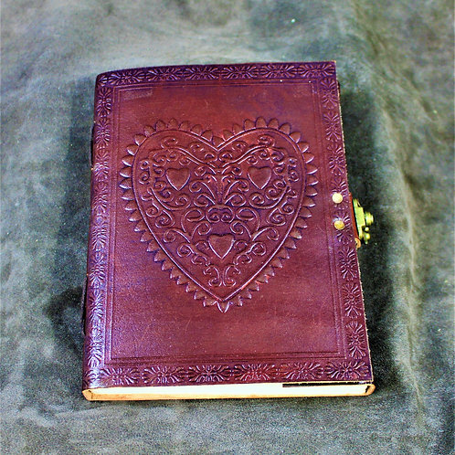 Red leather grimoire, spellbook, artbook or journal, heart motif