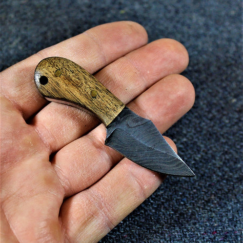 Tiny damascus neck knife, cute yet practical