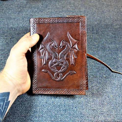 Red leather grimoire, spellbook, artbook or journal, twin dragon motif
