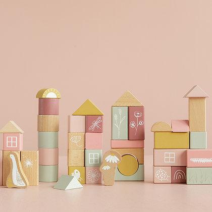 Tonneau de petits blocs de bois rose