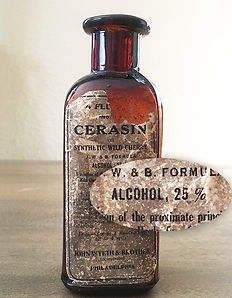 Antique medicine bottle with label indicating 25% alcohol content. Pharmaceuticals consisting of heavy metals such as mercury and arsenic was also common in the 1800s.
