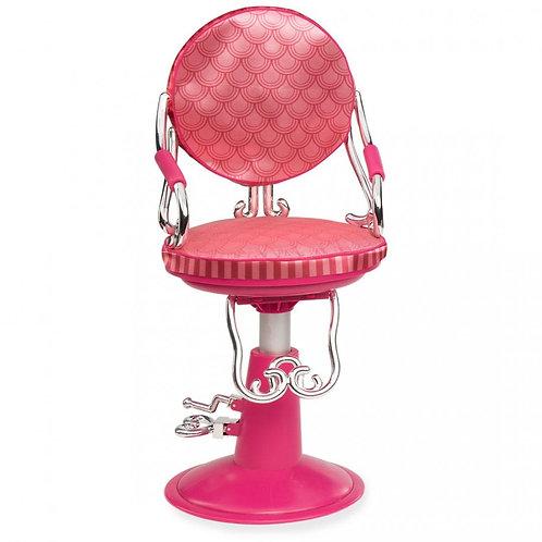 כסא מספרה אדום וכלי עיצוב שיער