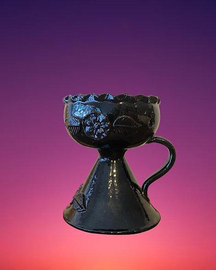 Black glazed copalero with handle