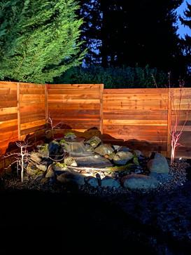 fence. outdoor lighting. waterfall