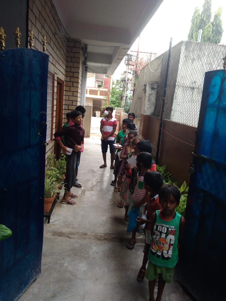 Food distribution at orphanage - Adileel
