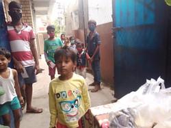 Food distribution at orphanage - Adileel