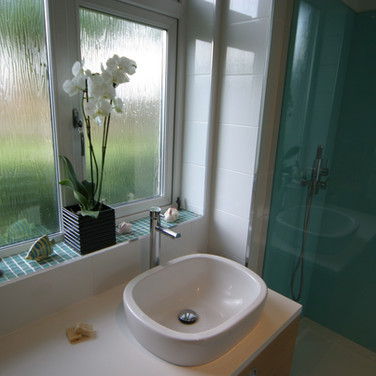 A gorgeous aqua and white shower room