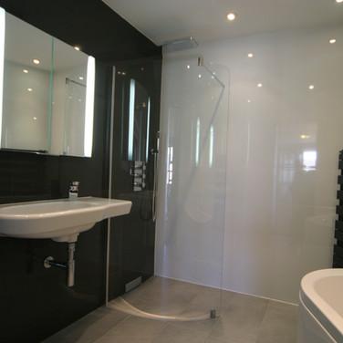 A stunning black and white tiled wet room