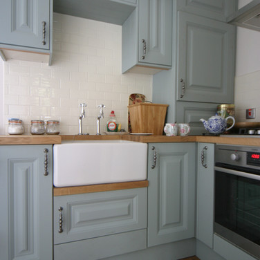 A beautiful dove blue hand painted wooden kitchen