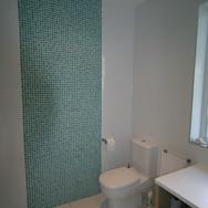 A gorgeous aqua and white shower room