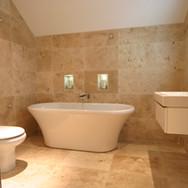 A classical travertine bathroom