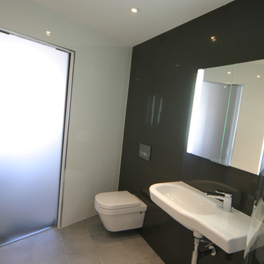 A stunning black and white tiled wet room