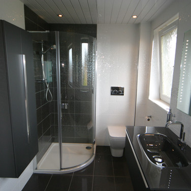 A beautiful black and white tiled bathroom