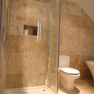 A classical travertine bathroom