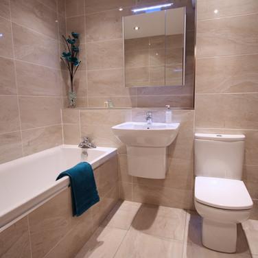 A beautiful marble tiled bathroom-bath-sin