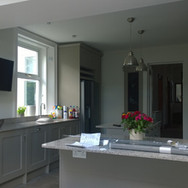A traditional khaki and stone grey hand painted kitchen extension