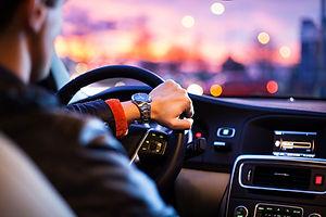 man-driving-in-car-in-the-city-ride-share-uber-lyft-getaround-zipcar.jpg