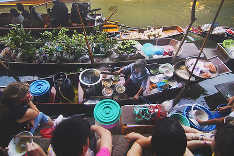A Boat Market in Bangkok, Thailand. Here you'll find our Top Food Blogs and Food Guides.