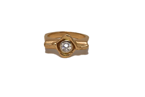 18K Gold Ring with a approximately .37 Diamond