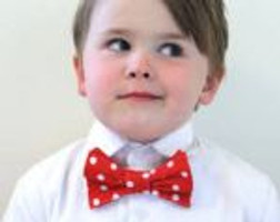 Adorable child with bow tie.
