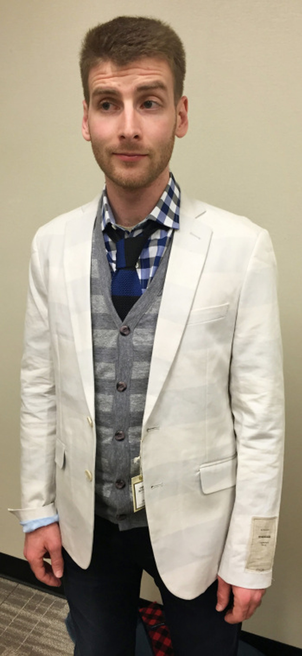 Paired with a gingham shirt, knit tie, and cardigan sweater, it's preppy with a side of grunge.