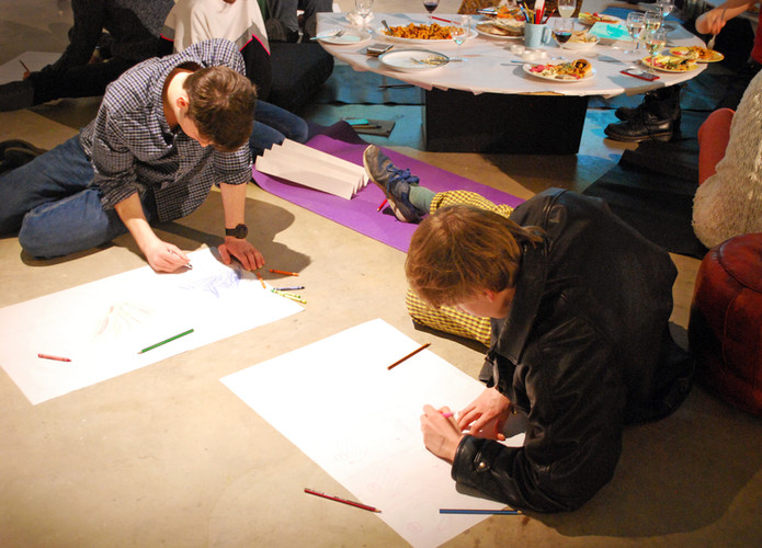Participants engage in an exercise of expressing eachother's work by visual means