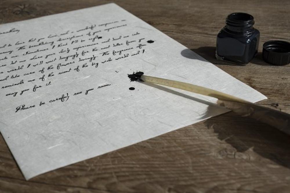 Quill pen on a handwritten letter