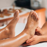Foot reflexology massage. Female therapi