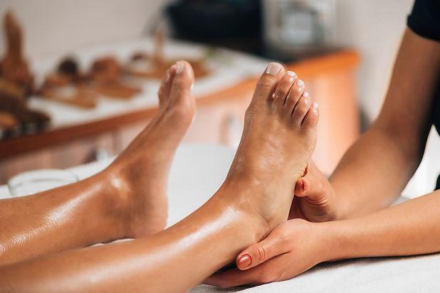 Foot reflexology massage. Female therapi