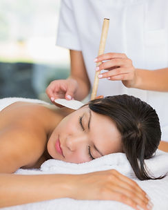 Relaxed brunette getting an ear candling