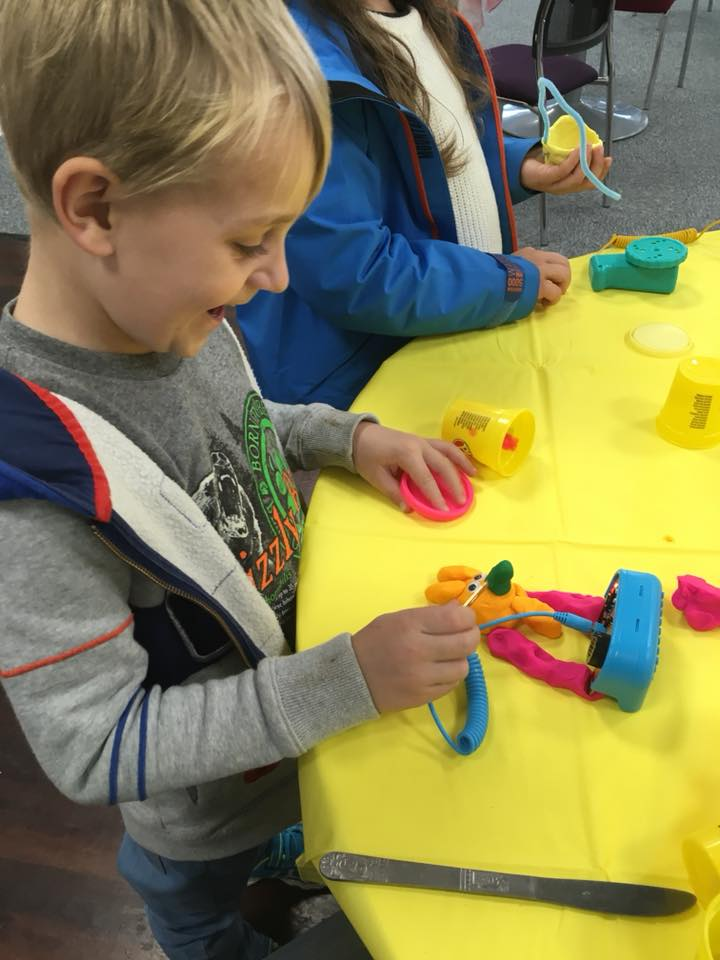 Boy playing with playdough