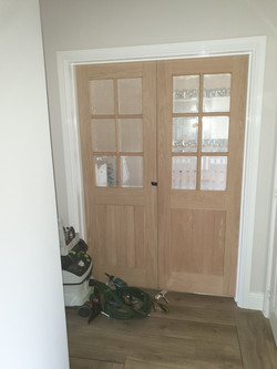Pair of glazed doors to the dining room prior to varnish