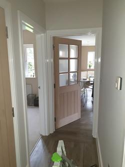 Part glazed door to kitchen prior to varnish