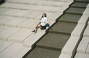 woman on large cement stairs uid 1176706
