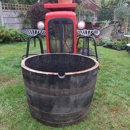Genuine Ex Whiskey Barrel Planter.