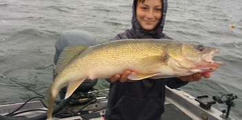 Mille Lacs Lake fishing Guide client with a big walleye
