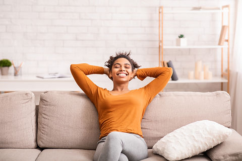 Feb 21 - Woman smiling on the couch .jpg