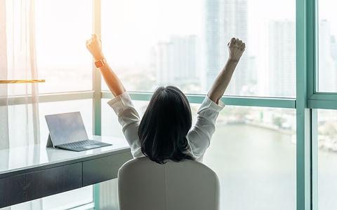 Aug 21 - happy businesswoman relaxing in office.jpg