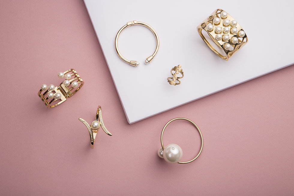 Pearl Golden Bracelets and ring on pink