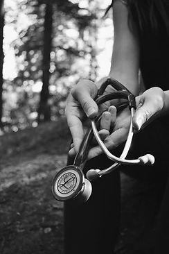 naturopath holding stethoscope