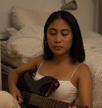 Elyssa Plaza playing guitar