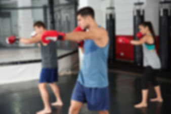 Young boxers warming up before training