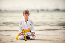 girl beach meditate.jpg